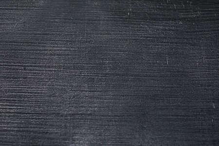 Dark black grunge textured wall closeup macro