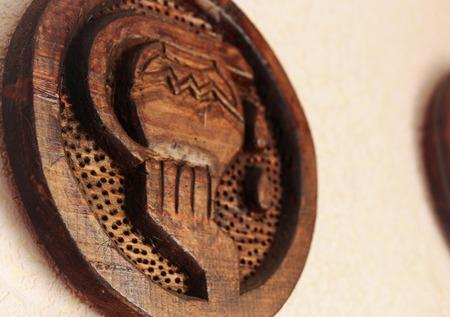 foretell: Aquarius - zodiac sign made of wood Stock Photo