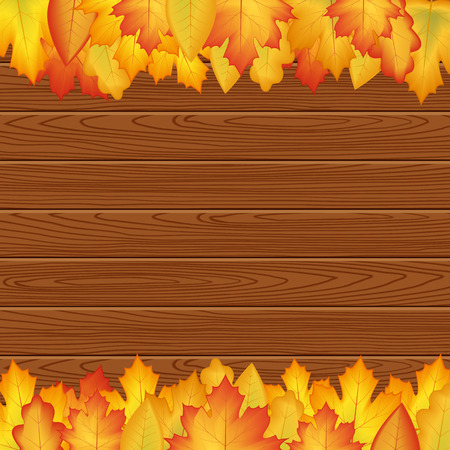 design autumn poster. Yellow, orange leaves on a wooden texture, frame for text.