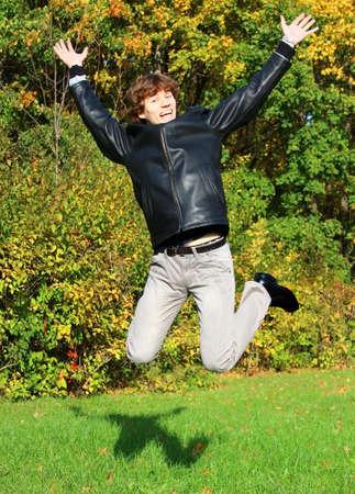 bod: joyful boy jumping in autumn park Stock Photo