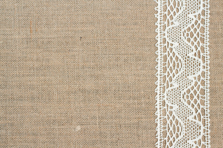 burlap background: Burlap background with lace Stock Photo