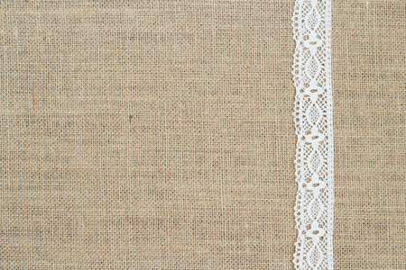 Burlap background with lace Archivio Fotografico