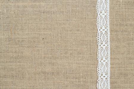 Burlap background with lace Archivio Fotografico
