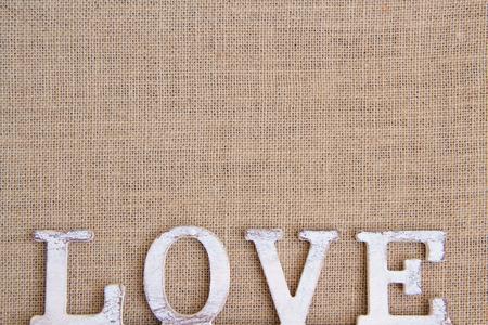 chic: Word love on burlap Shabby chic  Stock Photo