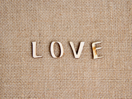 amore: Word love on burlap