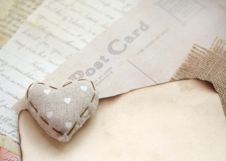 Shabby chic heart on vintage postcard and paper photo