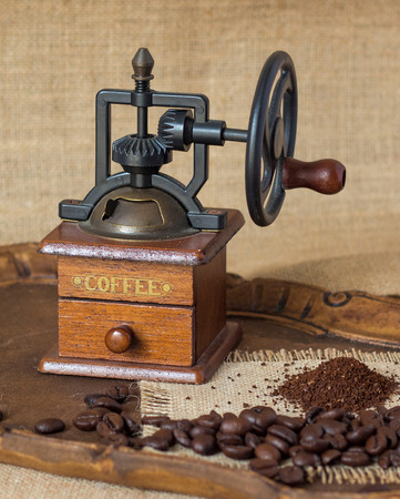 Antique coffee grinder and coffee beans photo