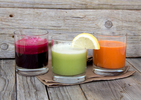 lemon juice: Fresh  juices - red beet, cabbage and carrot Stock Photo