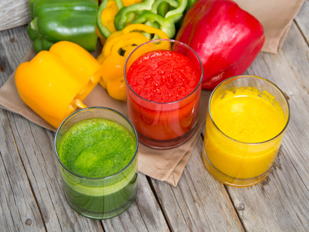 Fresh smoothies in the glass - green, red and yellow paprika Stock Photo