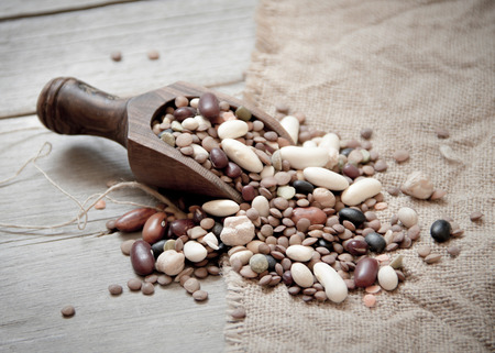 Legumes mix in the wood spoon photo