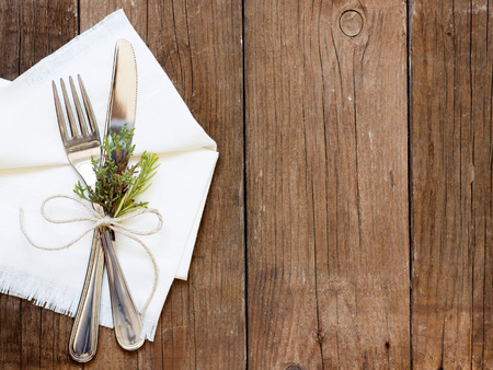 Rustic Table setting with juniper decor on old wooden table