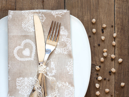 Rustic Table setting with vintage lace ribbon on old wooden table photo