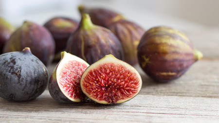 Fresh fruits - figs on the wooden table Archivio Fotografico