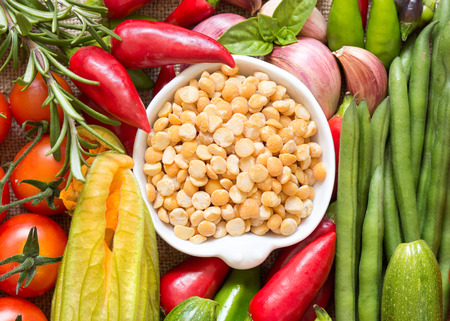 Raw Organic yellow peas and vegetables photo