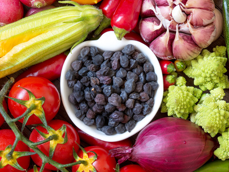 Black chickpea in a bowl with vegetables Stock Photo