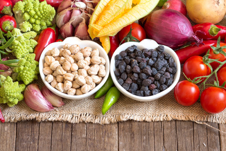 red gram: Black and white chickpea in bowls with vegetables