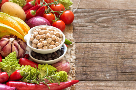 Black and white chickpea in bowls with vegetables photo