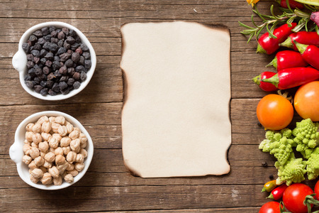 red gram: Vegetables, paper and chickpea on a wooden table background