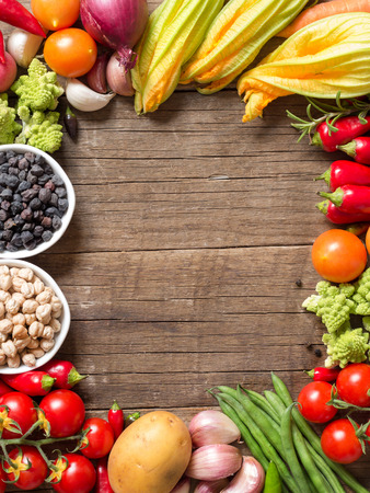 Vegetables and chickpea on a wooden table  background photo