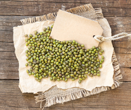 Mung beans and paper label on a wooden table photo
