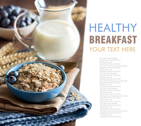 rolled oats: Rolled oats in a blue bowl with berries and milk