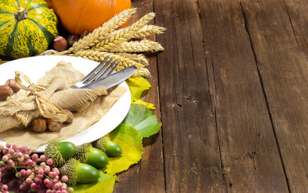 Rustic autumn table setting on wooden table photo