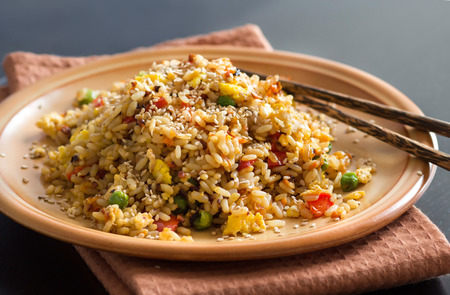 brown rice: Fried Rice with Vegetables and fried eggs - Chinese Cuisine Stock Photo