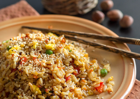 brown: Fried Rice with Vegetables and fried eggs - Chinese Cuisine Stock Photo