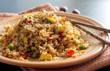 Fried Rice with Vegetables and fried eggs - Chinese Cuisine 免版税图像