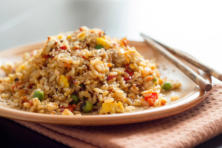 Fried Rice with Vegetables and fried eggs - Chinese Cuisine Stock Photo