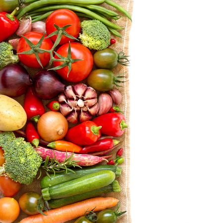 Colorful vegetables border on a white background Stock Photo