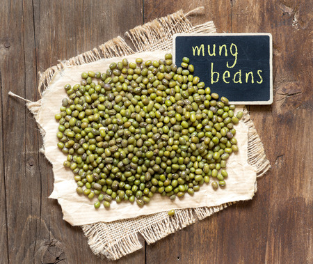 Mung beans with small chalkboard on a table photo