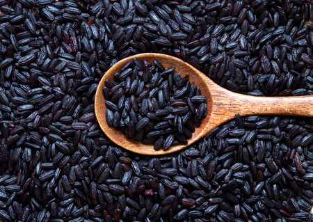 black rice: Black rice with a spoon close up