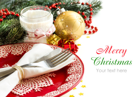 Festive table setting with candle holder and red plate photo