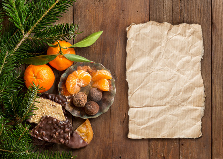 craft paper: Chocolate, truffles and tangerins with fir and craft paper