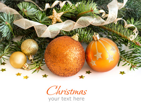 Golden Christmas ornaments border on white background