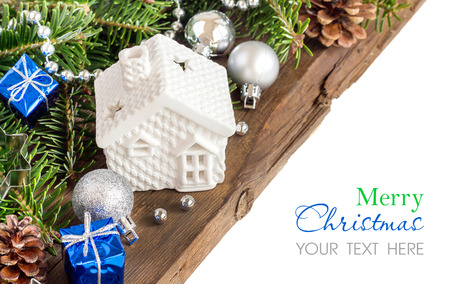 Festive decorations with small house, baubles and gift boxes photo