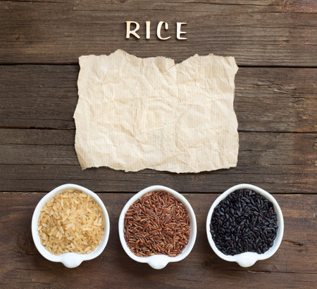 craft paper: Variety of rice with craft paper and word Rice on wood