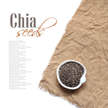 Chia seeds in bowl on a white background Stock Photo