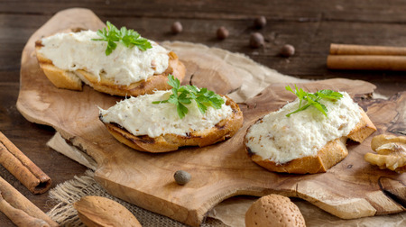 codfish: Toasted bread with a salted codfish mousse on wooden cutting board