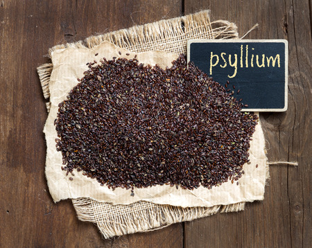 albumin: Psyllium seeds with a small chalkboard on wooden background Stock Photo