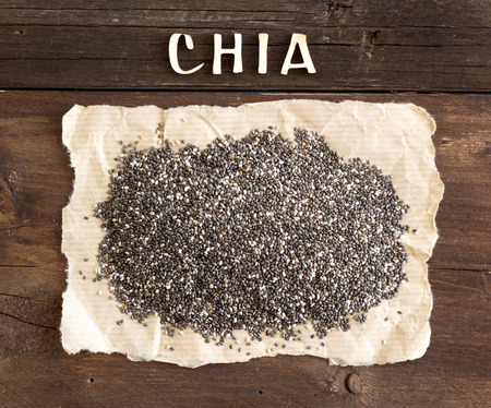 Chia seeds with a word CHIA on wooden background