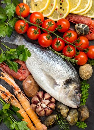 Fresh dorado fish,  seafood and vegetables