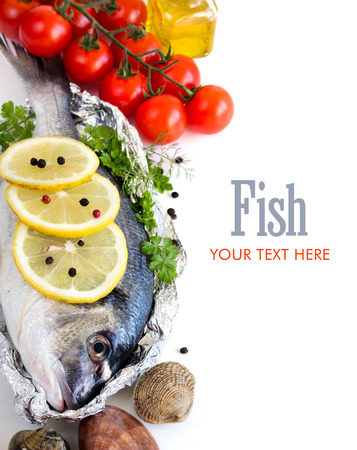 Fresh dorado fish, seafood and vegetables on a white background photo