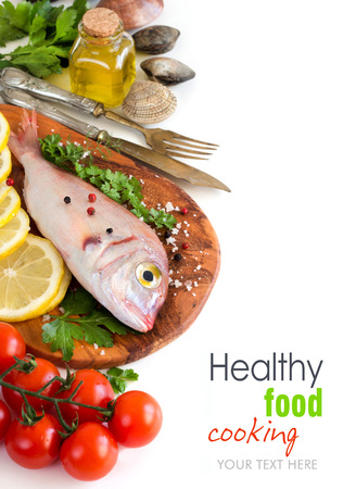 diet dinner: Fresh fish on a wooden board isolated on white Stock Photo
