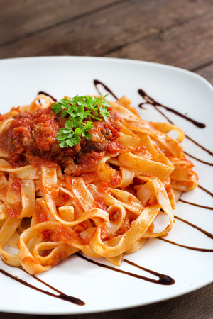 Tagliatelle with wild boar ragu made in  italian style