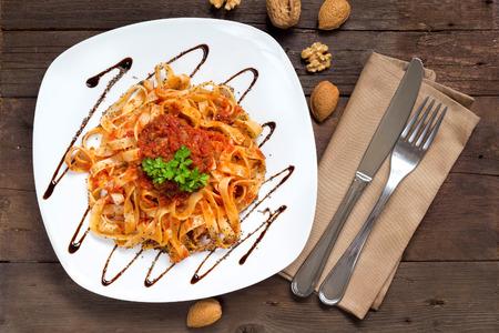 Tagliatelle with wild boar ragu made in  italian style