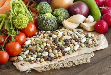 Mixed legumes and vegetables on a wooden table
