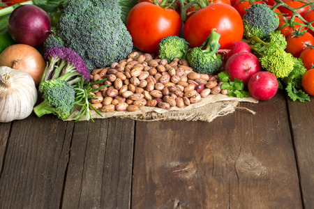 pinto beans: Pinto beans and vegatables on the old wooden table Stock Photo