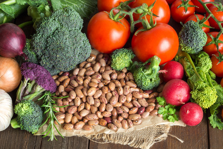 pinto beans: Pile of pinto beans and vegetables on a wooden bacground